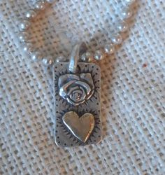 Hearts and Roses. 14kt Gold heart on sterling pendant. Margaret Sullivan