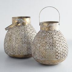 Our metal lantern filters candlelight through its intricately pierced design. With a heavily distressed finish, this antique-inspired piece exudes a rustic appeal. Gold Lanterns, Metal Lanterns, Hanging Lanterns, Candle Lanterns, Tea Light Candles, Garden Lanterns, Lantern Craft, Home Air Fresheners, Hearth And Home