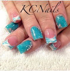 Blue & white acrylic nails. Solid and french tip. Hand painted blue zebra print nail art and 3D crystal accents.  KCNails