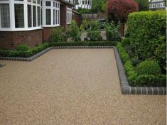 Resin Bound Gravel driveway Driveway - chocolate buff gravel Edging kerbs - charcoal bull-nose (Brett) Threshold - reclaimed blue clay bricks Porch step - grey slate slab& Resin Bound Gravel driveways provide a permeable solution. Permeable Driveway, Resin Driveway, Gravel Driveway, Concrete Driveways, Driveway Landscaping, Driveway Border, Walkways, Gravel Path, Landscaping Ideas