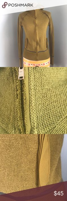"""JNBY Hooded Zip Sweater in Olive Green JNBY hooded zip sweater has beautiful details — see photos — and blue contrast mesh accents. In EUC with no signs of wear. 22"""" long, 19"""" at bust flat.   Unless otherwise noted, items I'm selling have been worn and will show signs of typical wear. I will note any issues. All items ship promptly from my non-smoking, clean, cat-friendly home. JNBY Sweaters Cardigans"""