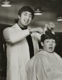 Dezo Hoffman, 1912 Title: Lennon, cigarette clenched in smiling teeth, wearing a white barber's jacket about to 'cut the hair' of Paul McCartney Ref. 1 Medium: Gelatin Silver Print Mount: unmounted Print Date: 1964 Photo Date: 1964 Beatles Love, Beatles Photos, Beatles Funny, Great Bands, Cool Bands, Lowrider, The Quarrymen, John Lennon Paul Mccartney, John Paul
