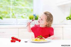 "Pobierz zdjęcie royalty free  ""Adorable toddler girl eating spaghetti in white…"