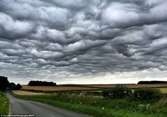 These extraordinary images show a series of wavelike clouds looming over the south coast. The unique formation, known as Undulatus asperatus, develops when undulation in the atmosphere causes air to move up and down