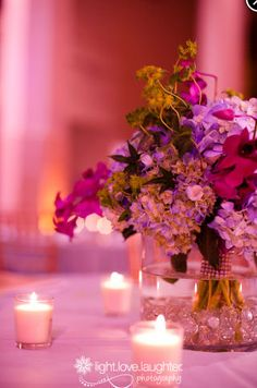 #centerpiece featuring hydrangeas, purple orchids and greenery accents, gathered bouquet style and stem-wrapped with bling!