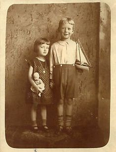 1928 German photo girl with doll boy with sailboat