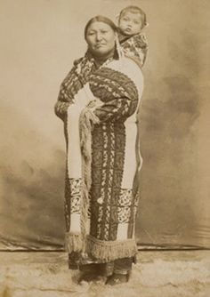 An old photograph of a Kiowa Mother and Baby Daughter.