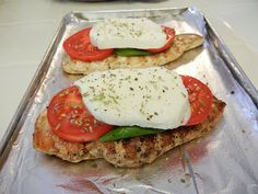 Shelly's Caprese Chicken: Place a leaf of fresh Basil, a couple of sliced Tomatoes and a slice of fresh Mozzarella on a Grilled Chicken Breast. Broil till cheese is gooey and melty.