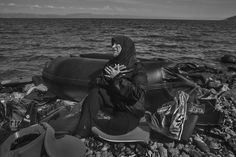 James Nachtwey: The Journey of Hope. Image 5 of 9.  Leaving behind everything they've ever known migrants arrive on the beach in Lesbos Greece with little or no possessions. A woman sits on the beach recovering from the sea journey Sept. 27. Photograph by James Nachtwey for @TIME. #refugeecrisis  See more images on lightbox.time.com. by time