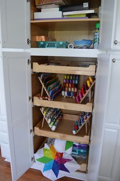 pull-out shelves aren't just for kitchen cabinets -- they work great in furniture pieces, as shown here in a craft area -- from Craftsy -- Kimberly Einmo's sewing room organization