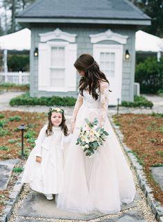 Sweet bride + flower girl moment: http://www.stylemepretty.com/2016/07/14/cozy-and-elegant-old-edwards-inn-wedding/ | Photography: Graham Terhune Photography - http://grahamterhune.com/