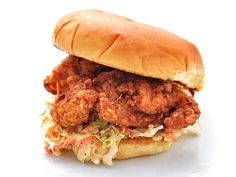 Fried chicken sandwiches Kosher salt Sugar 8 boneless skinless chicken thighs 2 tablespoon freshly ground black pepper 1 tablespoon paprika 2 large eggs 1 cup buttermilk 2 cups all-purpose flour 2 quarts peanut oil 1 recipe Creamy Cole Slaw 8 soft hamburger buns, toasted
