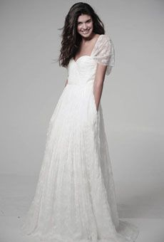 SAW THIS DRESS (WITH A BELT) IN THE WINDOW OF A BRIDAL SHOP- I ABSOLUTELY LOVE IT.