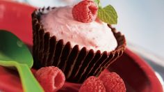 Serve mousse in tasty chocolate cups and top it with raspberry - perfect for dessert.