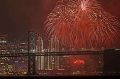 New Year celebrations around the U.S:    Fireworks explode over the San Francisco Oakland Bay Bridge as part of New Year's Eve celebrations Sunday, January 1, 2017, in San Francisco.