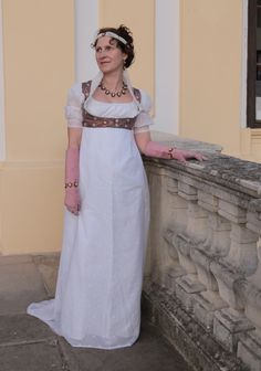 The empire embroidered muslin petticoat and a silk bodice with a muslin sleeves and pleated muslin collar