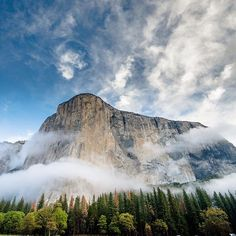 Photo by Chris Burkhard. Laying in the meadow with barefeet in the grass, staring up at this amazing feature... It makes you realize how perfectly named El Capitan is and how it truly demands your attention. #Beautiful #national #parks #America #100years #photography
