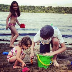 Grandaughters, Mary-Grace, Emma & grandson Hayden, playing in the sand.