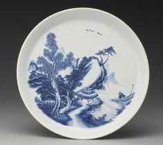 A BLUE AND WHITE 'LANDSCAPE' DISH, QING DYNASTY, EARLY KANGXI PERIOD