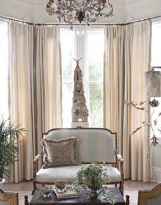 A French parlor suite wears a Libas silk stripe.