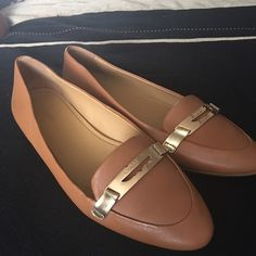 Coach Sz 9 comfortable Gold and brown lightly used small tear on inside of shoe  shown in last picture Coach Shoes Flats & Loafers