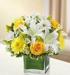 Healing Tears - Yellow and White Arrangement Send a bright and beautiful message of your care. This graceful yellow and white arrangement of roses, lilies, cremones, alstroemeria, daisy poms and solid