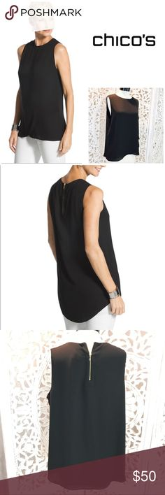 NWT Chicos Classic Layer Jade Tank Black 2 ( 12 ) Easy, airy and needless to say, essential. This flowing sleeveless top creates a modern feminine silhouette with beautiful crossover layering.  Flyaway overlay. Model pic for reference only.  Back zipper detail. Polyester Chicos NWT black open arms size 12 or 2 in Chicos Large Top Shirt Chico's Tops Tank Tops