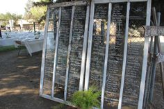 Seating Assignments written on Vintage Barn Windows at this Rustic Wedding.  By Calligraphy by Tammi