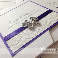 The Snow White Collection - Pocketfold Invitation | Featuring ivory lace, cadburys purple ribbon and pearl and crystal diamante butterfly embellishment | Luxury handmade wedding invitations and stationery #byenchanting