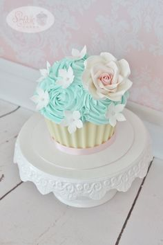 Vintage pink teal ivory and white chocolate giant cupcake - smash cake with edible rose and flowers.