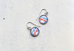 Colored design silver colored dangle glass cabochon by Anchy, $7.50