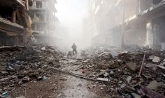 Man among the rubble in Syria.