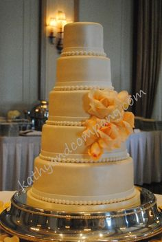Satin look wedding cake with fresh rose cluster