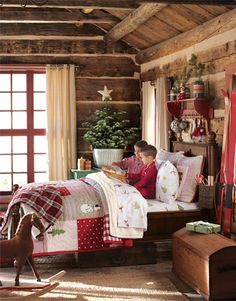 Why This Room Works We wanted to bring the warmth and spirit of the holidays to this room. We started with hand-quilted bedding featuring the season's most beloved characters and icons, and then continued the theme by hanging small crafty ornaments from the shelves and hooks above the bed. Rustic wood paneling and a freshly cut tree add to the rich seasonal style and flannel sheets and pjs encourage kids to settle in for a long winter's nap.
