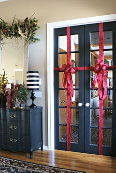 Doors wrapped with ribbon for Christmas.