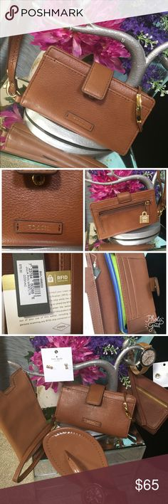 Fossil IPhone RFID Wristlet Perfect to carry all your essentials when you're on the go! Your cash, cards, coins & IPhone 6. [HA.S16]. 🚫Trades. RFID protection. Last photo shows other newly listed Fossils and more. Fossil Bags Clutches & Wristlets