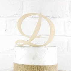 """5 Inch Rustic Wedding Cake Topper Monogram Personalized in Any Letter A B C D E F G H I J K L M N O P Q R S T U V W X Y Z. Our toppers are made from 1/8"""" Baltic Birch Wood and have a 2"""" tall stake. CakeTopperMonograms also offers custom designs based on artwork you provide. If you have a custom design in mind, send it over and we can work with you to create a topper custom tailored to you! **Have A Smaller or Larger Cake?** We build custom sized toppers all the time. Just let us know what..."""