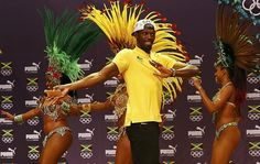 As a dozen scantily clad Brazilian Samba dancers gyrated on to the stage, rocking peacock-style headdresses and glittery thongs, Usain Bolt was not about to be intimidated or upstaged.