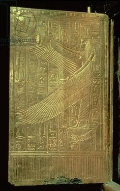 The goddess Isis from the inside of one of the double doors of the third gilded shrine, from the tomb of Tutankhamun (c.1370-52 BC) New Kingdom (gilded wood), Egyptian 18th Dynasty (c.1567-1320 BC) / Egyptian National Museum, Cairo, Egypt / Bridgeman Images