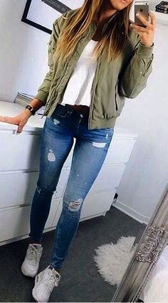 65 Fall Outfits for School to COPY ASAP I love these fall winter outfit ideas that anyone can wear teen girls or women. The ultimate fall fashion guide for high school or college. Cute simple look with ripped blue jeans sneakers and a green bomber jacket. Winter Outfits For Teen Girls, Fall Outfits For School, Fall Winter Outfits, Fall Fashion For Teen Girls, Cute Outfit Ideas For School, Simple Outfits For Teens, Cute Highschool Outfits, College Girl Outfits, Cute Simple Outfits