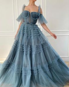 Get lost in a sea of celestial blue texture. The Ethereal Ruffled Gown is made of delicate tulle fabric with an A-line silhouette for waist definition. Pleated, tiered floor-length skirt with off-the-shoulder sleeves and a bustier style bodice. Ball Dresses, Ball Gowns, Evening Dresses, Prom Dresses, Formal Dresses, Wedding Dresses, Elegant Dresses, Pretty Dresses, Beautiful Dresses
