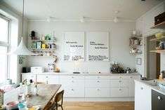 white kitchen with storage options and pine table