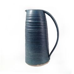 Beautiful ceramic tall water jug by Dove Street Pottery.  Wheel thrown stoneware bowl in teal blue glaze which is lead free and food safe.