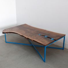 Made by UHURU. Never seen color added to the base of a slab table. Completely changes the character and elegance of the black walnut. To each his own! stitch_table_uhuru_design_6b.jpg