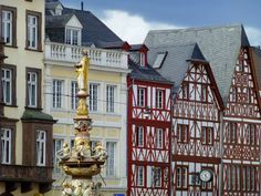 https://flic.kr/p/qb2raP | Hauptmarkt in Trier, Germany |  Buy this photo on Getty Images : Getty Images     Main market square in Trier with half-timbered buildings and the St. Peters fountain.  You'll find this beautiful fountain in the Hauptmarkt. It was built at the end of the 16th century. Obviously, it is St Peter who adorns the top of the fountain. Below him are figures representing the four cardinal virtues - prudence, justice, fortitude and temperance.  Submitted 10/02/2015…