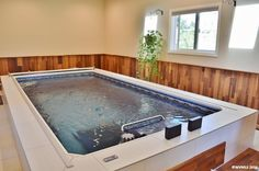 An Endless Pool installed indoors and partially inground in this Lebanon, Oregon, home.