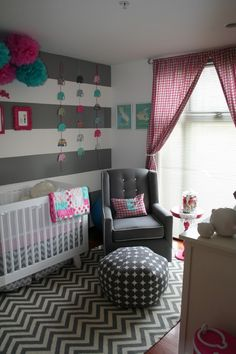 Grey Chevron crib skirt and rug in a stripe nursery with teal and magenta baby decor