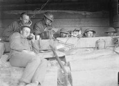 Royal Garrison Artillery telephonists at work passing messages from the forward observation officers to their batteries in a dug-out close to the front line near Langemarck, August 1917.