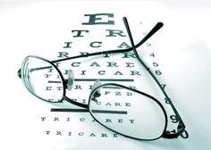 Eyeglasses sitting on Vision Chart