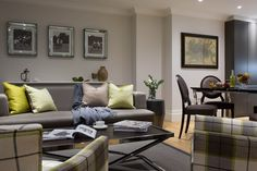 th2 Designs.© Luxurious penthouse reception, feature plaid armchairs, sofa with a lime scatter cushions. Polo photography artwork.